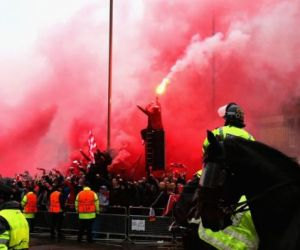 Two charged over assault on Liverpool fan
