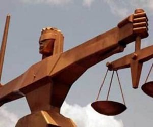 Divorced woman in court for refusing to leave ex-husband's house