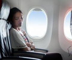 How to Sleep Comfortably On a Plane .html