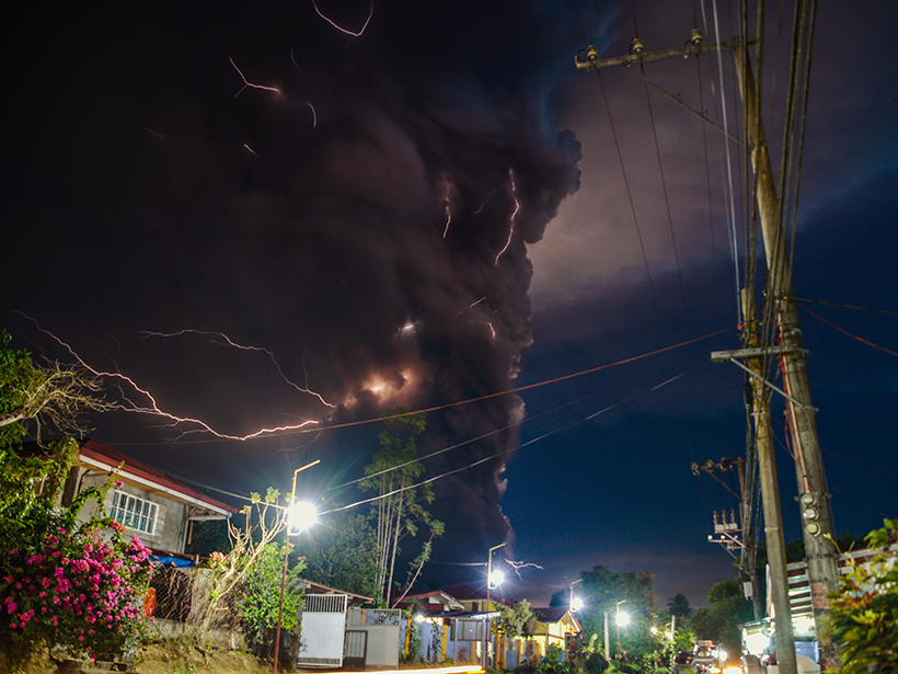 Philippines struggles to keep evacuees away from volcano